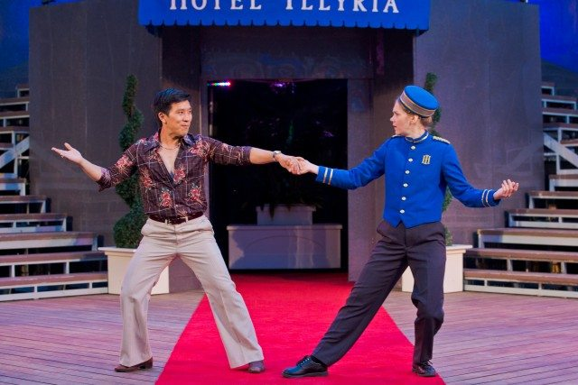 Duke Orsino (Richard Lee) and a disguised Viola (Amelia Sargisson) cut a rug in the Canadian Stage in High Park production of Twelfth Night. Photo by Cylla von Tiedemann.