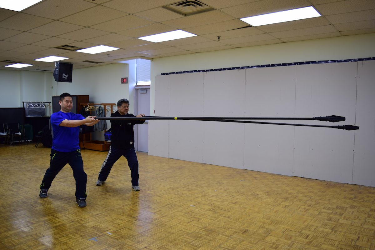 James Guo, right, and a student show off the da qiang weapon. Photo by Amir Aziz.